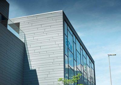 Centro-educativo-a-Insbruck--Sidings_doghe-grigio-chiaro-duesse-coperture
